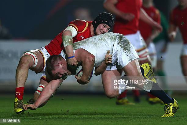 Jack Singleton of England U20 is tackled by Shaun Evans of Wales U20 during the Six Nations match between England U20 and Wales U20 at Ashton Gate on...