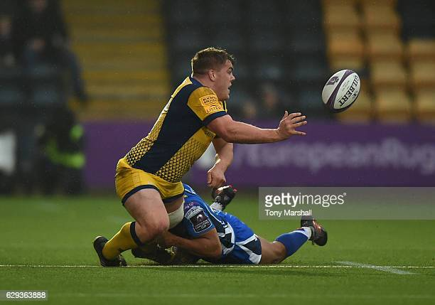 Jack Singleton of Worcester Warriors is tackled by Ashton Hewitt of Newport Gwent Dragons during the European Rugby Challenge Cup match between...