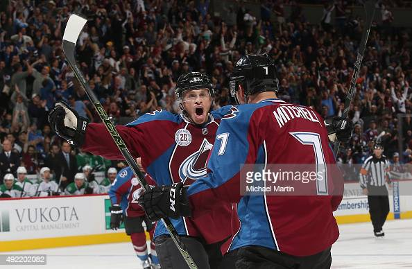 Jack Skille of the Colorado Avalanche celebrates with John Mitchell after Mitchell's goal against the Dallas Stars at the Pepsi Center on October 10...