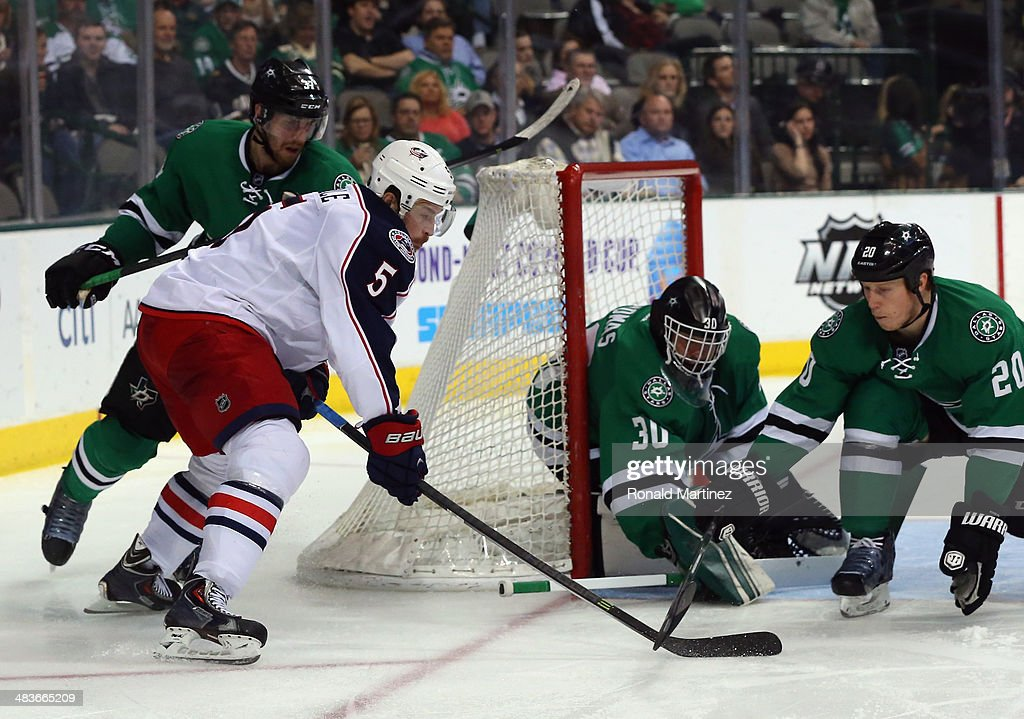 Jack Skille #5 of the Columbus Blue Jackets takes a shot against Tim Thomas #30 of the Dallas Stars in the second period at American Airlines Center on April 9, 2014 in Dallas, Texas.