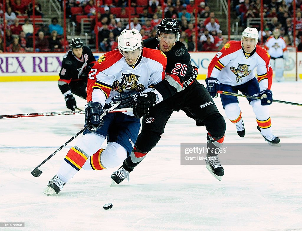 <a gi-track='captionPersonalityLinkClicked' href=/galleries/search?phrase=Jack+Skille&family=editorial&specificpeople=697014 ng-click='$event.stopPropagation()'>Jack Skille</a> #12 of the Florida Panthers battles for the puck with Riley Nash #20 of the Carolina Hurricanes during play at PNC Arena on March 2, 2013 in Raleigh, North Carolina.