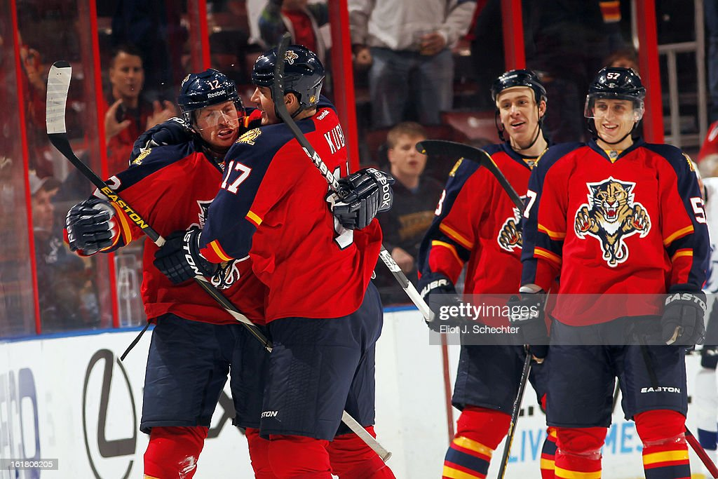 Jack Skille #12 of the Florida Panthers celebrates his goal with teammate Filip Kuba #17 against the Tampa Bay Lightning at the BB&T Center on February 16, 2013 in Sunrise, Florida.