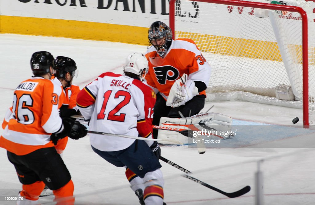 Jack Skille #12 of the Florida Panthers scores a first-period goal against Ilya Bryzgalov #30 of the Philadelphia Flyers on February 7, 2013 at the Wells Fargo Center in Philadelphia, Pennsylvania. The goal was Skille's first of the season.