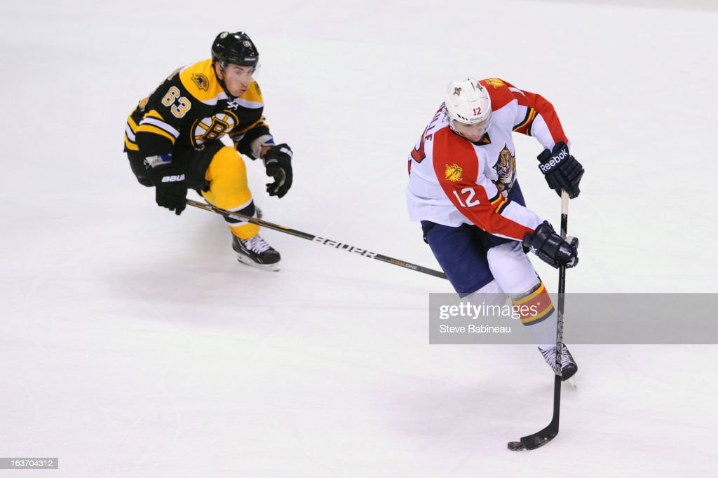 <a gi-track='captionPersonalityLinkClicked' href=/galleries/search?phrase=Jack+Skille&family=editorial&specificpeople=697014 ng-click='$event.stopPropagation()'>Jack Skille</a> #12 of the Florida Panthers skates with the puck against <a gi-track='captionPersonalityLinkClicked' href=/galleries/search?phrase=Brad+Marchand&family=editorial&specificpeople=2282544 ng-click='$event.stopPropagation()'>Brad Marchand</a> #63 of the Boston Bruins at the TD Garden on March 14, 2013 in Boston, Massachusetts.