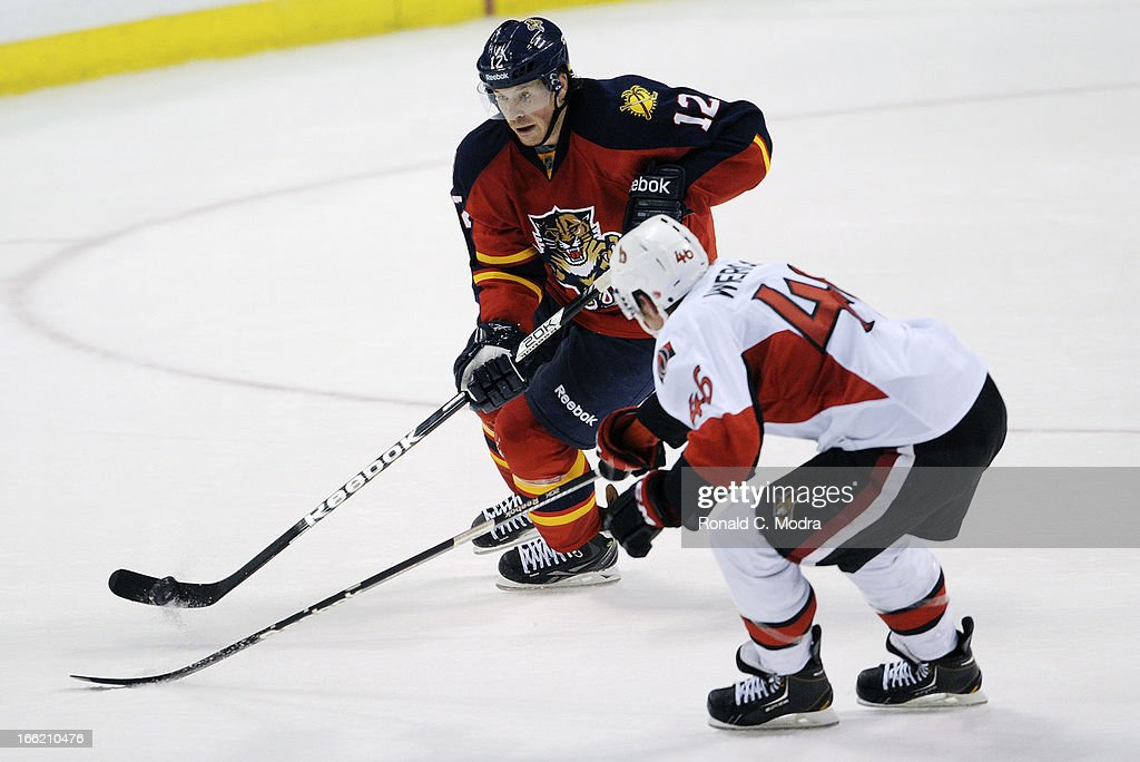 Jack Skille #12 of the Florida Panthers skates with the puck as Patrick Wiercioch #46 of the Ottawa Senators chases during a NHL game at the BB&T Center on April 7, 2013 in Sunrise, Florida.