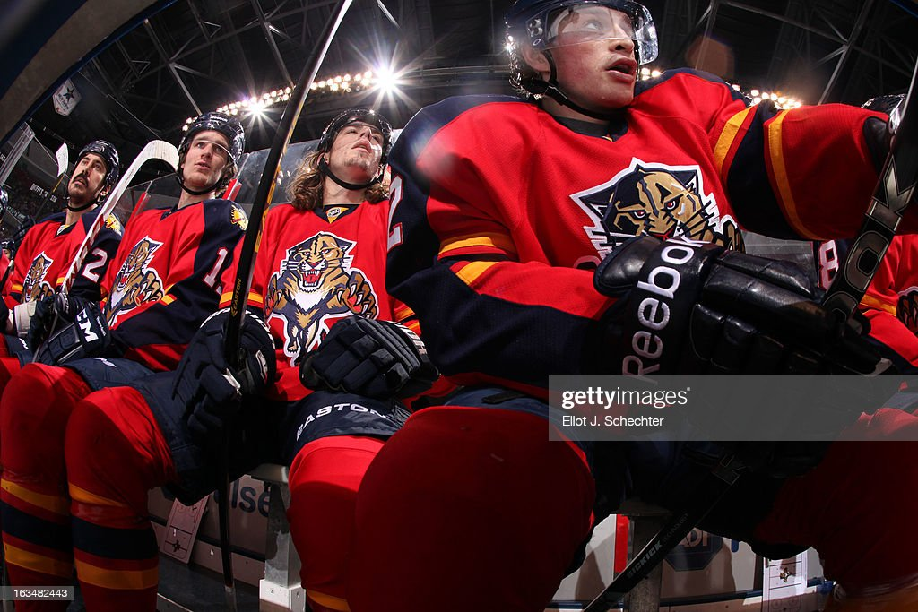 Jack Skille #12 of the Florida Panthers watches the action with teammates between shifts against the Montreal Canadiens at the BB&T Center on March 10, 2013 in Sunrise, Florida.
