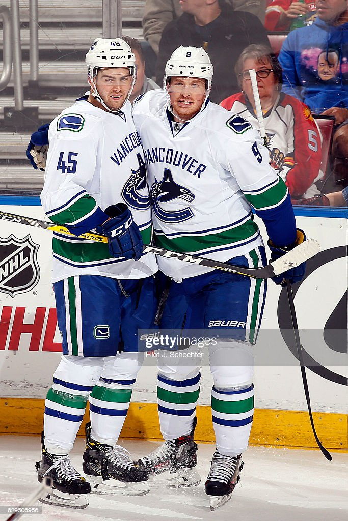 Jack Skille #9 of the Vancouver Canucks celebrates his goal with teammate Michael Chaput #45 against the Florida Panthers at the BB&T Center on December 10, 2016 in Sunrise, Florida.