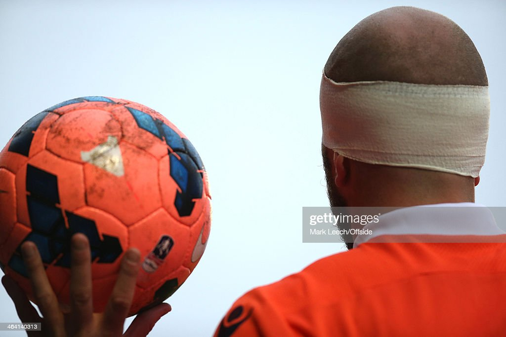 Jack Smith of Milwall prepares to take a throw with his head bandaged during the FA Cup Third Round match between Southend and Millwall at Roots Hall on January 4, 2014 in Southend, England.