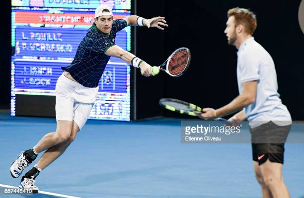 Jack Sock and John Isner of the United States in action during their Men's double first round match against Lucas Pouille of France and Fernando...