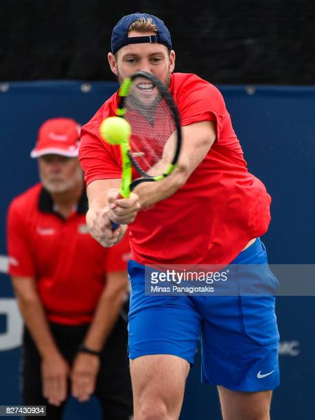 Jack Sock hits a return shot during his doubles match against Karen Khachanov of Russia and Dominic Thiem of Austria on day four of the Rogers Cup...
