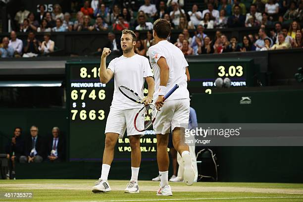 Jack Sock of the United States and Vasek Pospisil of Canada celebrate after winning the Gentlemen's Doubles Final against Bob Bryan and Mike Bryan of...