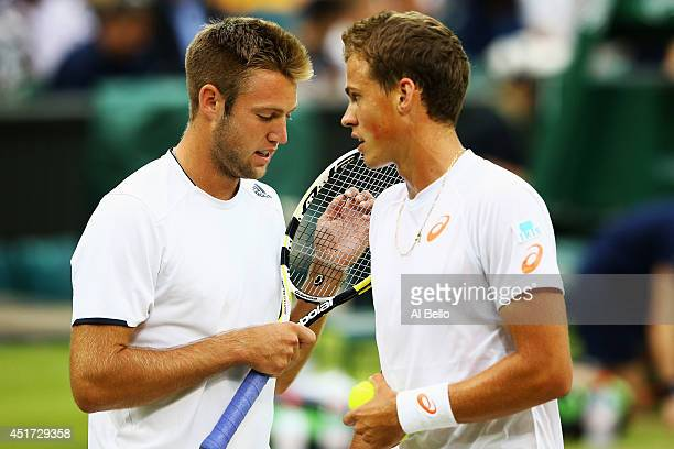 Jack Sock of the United States and Vasek Pospisil of Canada during their Gentlemen's Doubles Final against Bob Bryan and Mike Bryan of the United...