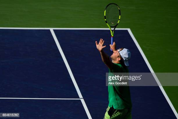 Jack Sock of the United States celebrates match point after defeating Kei Nishikori of Japan in the men's quarterfinals match on Day 12 during the...