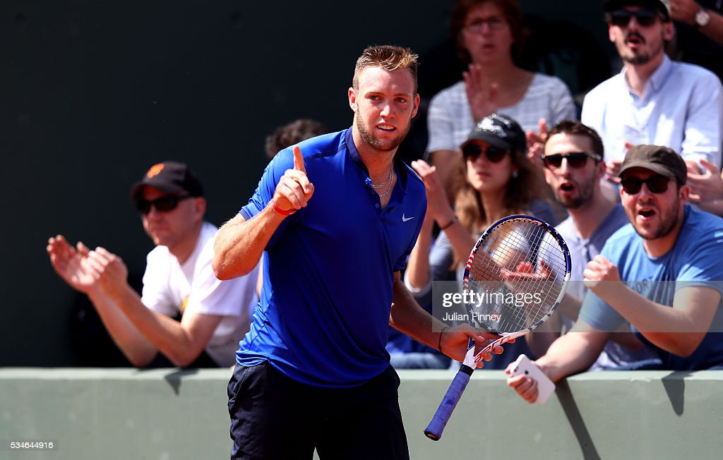 <a gi-track='captionPersonalityLinkClicked' href=/galleries/search?phrase=Jack+Sock&family=editorial&specificpeople=7157137 ng-click='$event.stopPropagation()'>Jack Sock</a> of the United States celebrates winning the first set during the Men's Singles third round match against Albert Ramos-Vinolas of Spain on day six of the 2016 French Open at Roland Garros on May 27, 2016 in Paris, France.