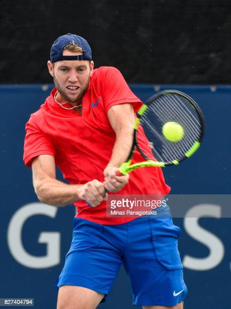 Jack Sock of the United States hits a return against Karen Khachanov of Russia and Dominic Thiem of Austria during day four of the Rogers Cup...