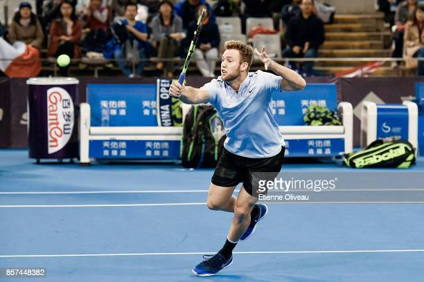 Jack Sock of the United States partner of John Isner of the United States in action during their Men's double first round match against Lucas Pouille...