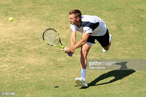Jack Sock of the United States plays a backhand during his match against Bernard Tomic of Australia during the Davis Cup tie between Australia and...