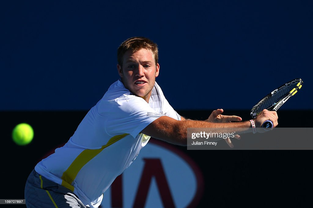 Jack Sock of the United States plays a backhand in his second round doubles match with Ashleigh Barty of Australia against Su-Wei Hsieh of Chinese Taipei and Rohan Bopanna of India during day six of the 2013 Australian Open at Melbourne Park on January 19, 2013 in Melbourne, Australia.