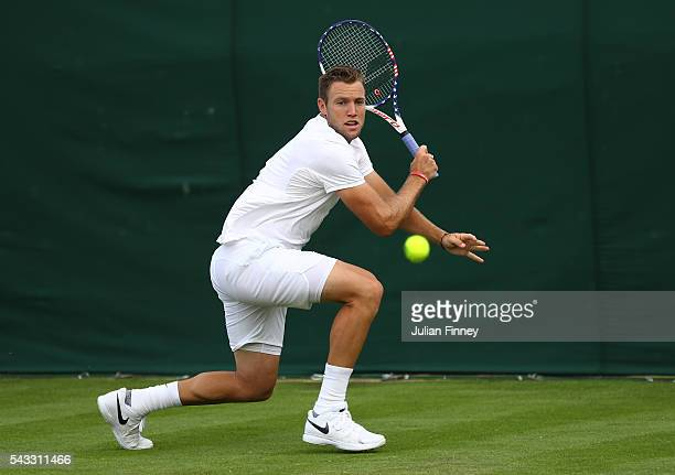 Jack Sock of The United States plays a backhand shot during the Men's Singles first round match against Ernests Gulbis of Latvia on day one of the...