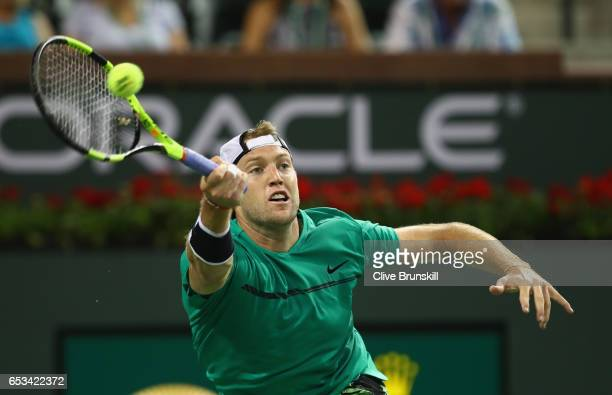 Jack Sock of the United States plays a forehand against Grigor Dimitrov of Bulgaria in their third round match during day nine of the BNP Paribas...