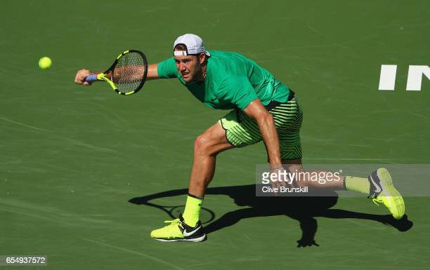 Jack Sock of the United States plays a forehand against Roger Federer of Switzerland in their semi final match during day thirteen of the BNP Paribas...
