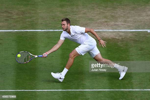 Jack Sock of The United States plays a forehand during the Men's Singles third round match against Milos Raonic of Canada on day six of the Wimbledon...