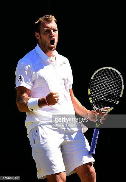Jack Sock of the United States reacts in his Gentlemens Singles first round match against Sam Groth of Australia during day two of the Wimbledon Lawn...