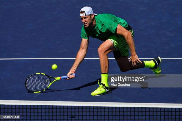 Jack Sock of the United States returns a shot to Roger Federer of Switzerland in the men's semifinal on day 13 during the BNP Paribas Open at Indian...