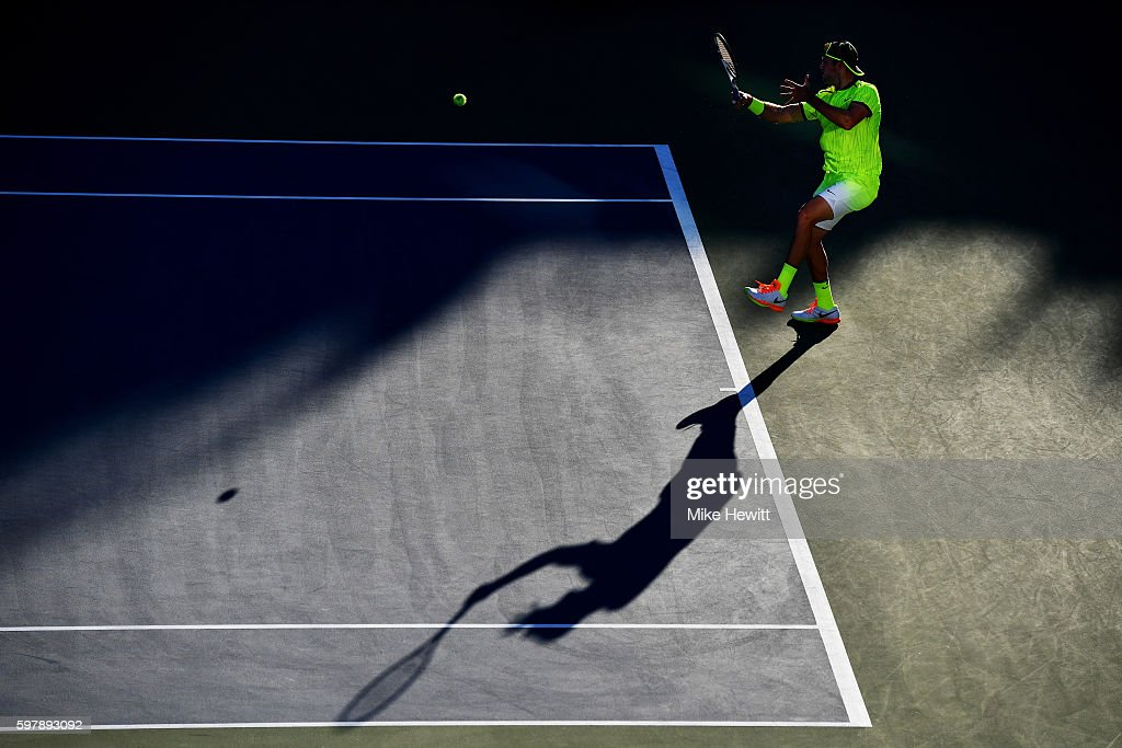 Jack Sock of the United States returns a shot to Taylor Fritz of the United States on Day One of the 2016 US Open at the USTA Billie Jean King...