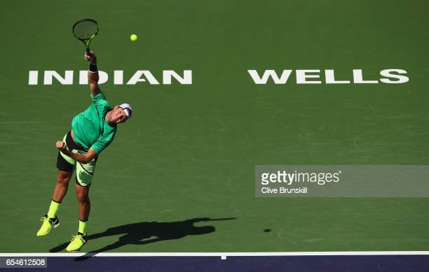 Jack Sock of the United States serves against Kei Nishikori of Japan in their quarter final match during day twelve of the BNP Paribas Open at Indian...