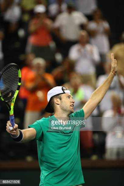 Jack Sock of the United States shakes waves to the crowd after his three set victory against Grigor Dimitrov of Bulgaria in their third round match...