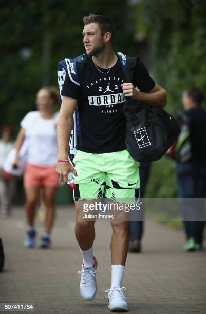 Jack Sock of the United States walks to practice on day two of the Wimbledon Lawn Tennis Championships at the All England Lawn Tennis and Croquet...