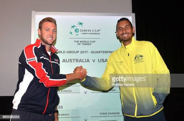 Jack Sock of the USA and Nick Kyrgios of Australia shake hands at the official draw for the Davis Cup World Group Quarterfinals between Australia and...