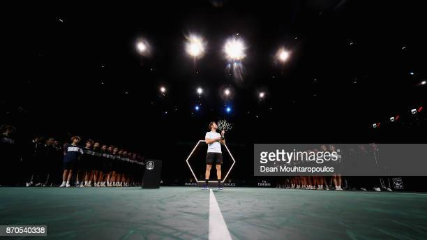 Jack Sock of the USA celebrates with the trophy after victory against Filip Krajinovic of Serbia in the Mens Final on day 7 of the Rolex Paris...