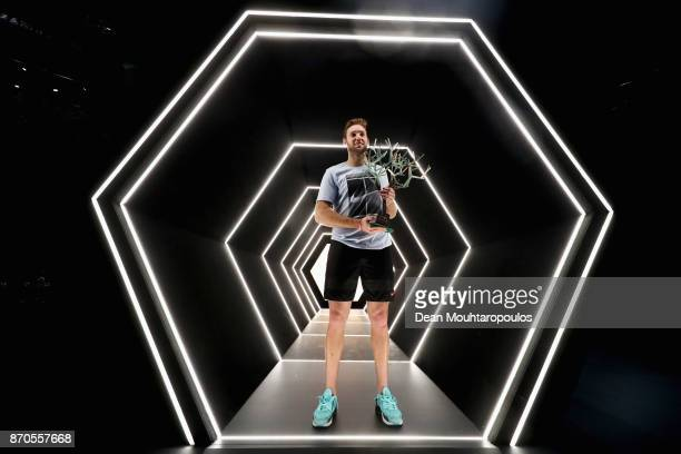 Jack Sock of the USA poses with the trophy in the players tunnel after victory against Filip Krajinovic of Serbia in the Mens Final on day 7 of the...