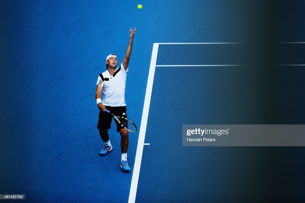 <a gi-track='captionPersonalityLinkClicked' href=/galleries/search?phrase=Jack+Sock&family=editorial&specificpeople=7157137 ng-click='$event.stopPropagation()'>Jack Sock</a> of the USA serves against Roberto Bautista Agut of Spain during day four of the Heineken Open at ASB Tennis Centre on January 9, 2014 in Auckland, New Zealand.