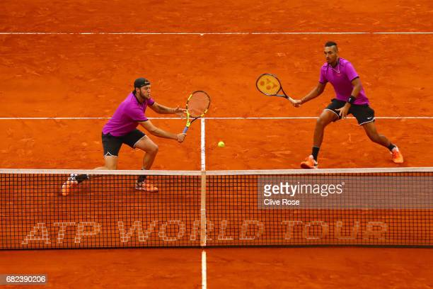 Jack Sock of USA and Nick Kyrgios of Australia in action during their match against Bob and Mike Bryan of USA on day six of the Mutua Madrid Open...