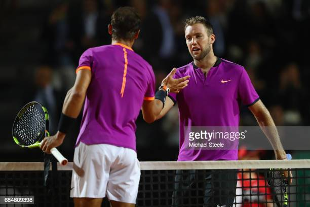 Jack Sock of USA shakes hands after losing in straight sets to Rafael Nadal of Spain during the men's third round match against Jack Sock of USA on...