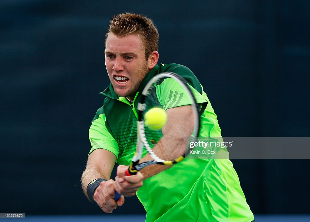 Jack Sock returns a backhand to Michael Venus of New Zealand during the BB&T Atlanta Open at Atlantic Station on July 23, 2014 in Atlanta, Georgia.