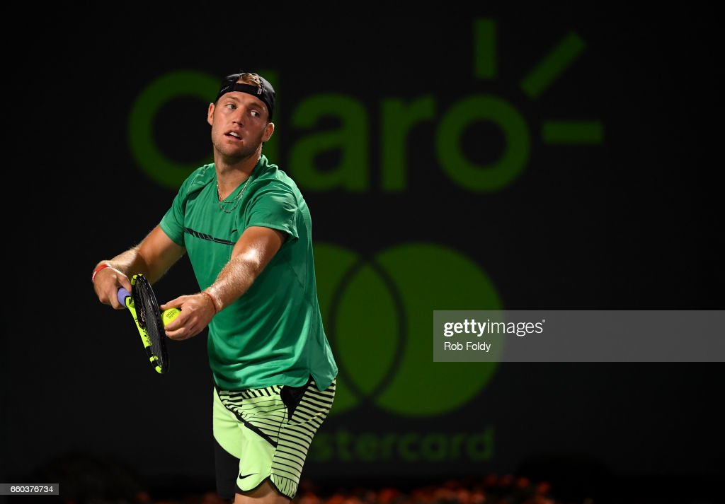Jack Sock serves during a match against Rafael Nadal of Spain at Crandon Park Tennis Center on March 29, 2017 in Key Biscayne, Florida.