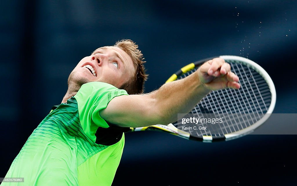 Jack Sock serves to Michael Venus of New Zealand during the BB&T Atlanta Open at Atlantic Station on July 23, 2014 in Atlanta, Georgia.