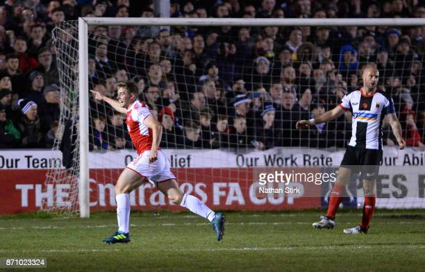 Jack Sowerby of Fleetwood Town celebrates after scoring the winner during The Emirates FA Cup First Round match between Chorley and Fleetwood Town at...