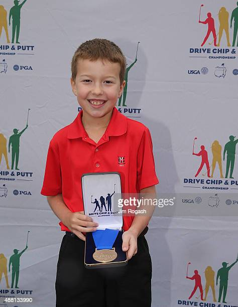 Jack St Ledger first place winner in the Boys 79 Chipping Competition poses with his medal during the 2015 Drive Chip and Putt Championship at The...