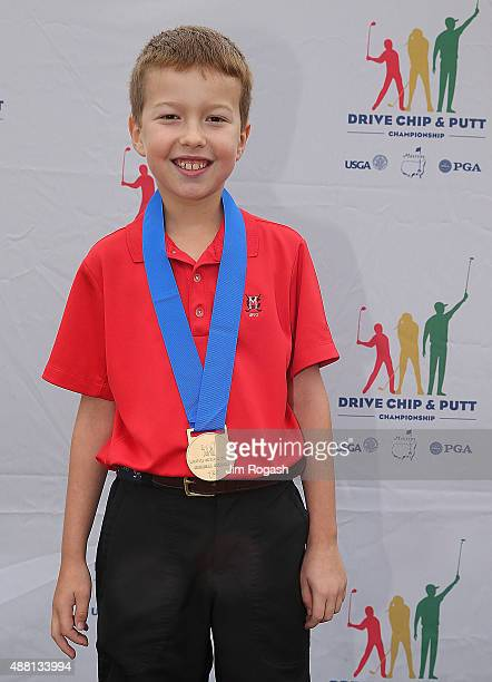 Jack St Ledger first place winner in the Boys 79 Overall Competition poses with his medal during the 2015 Drive Chip and Putt Championship at The...