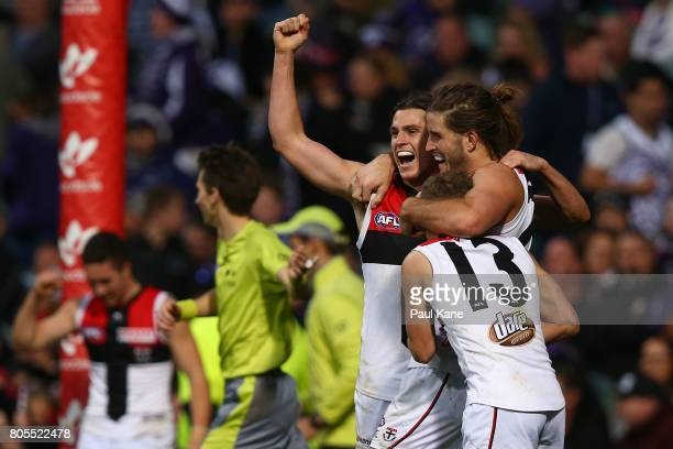 Jack Steele Josh Bruce and Jack Lonie of the Saints celebrate winning the round 15 AFL match between the Fremantle Dockers and the St Kilda Saints at...