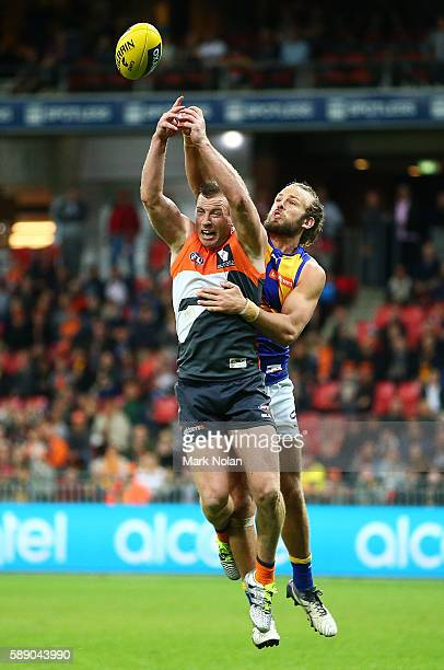 Jack Steele of the Giants and Will Schofield of the Eagles contest a mark during the round 21 AFL match between the Greater Western Sydney Giants and...