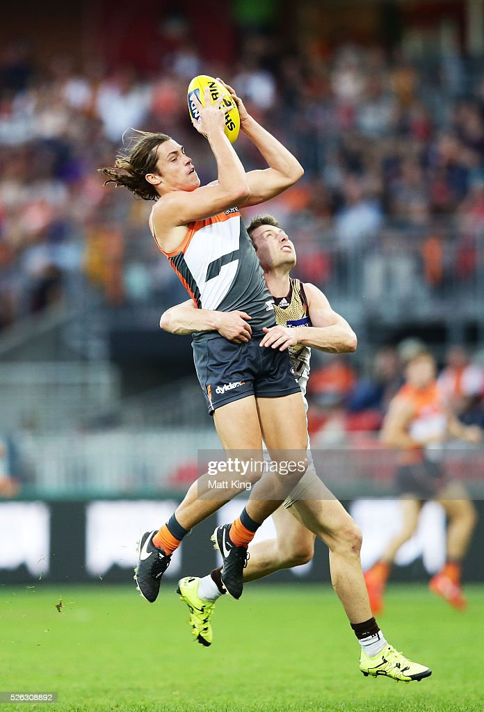 Jack Steele of the Giants takes a mark under pressure from Liam Shiels of the Hawks during the round six AFL match between the Greater Western Sydney Giants and the Hawthorn Hawks at Spotless Stadium on April 30, 2016 in Sydney, Australia.