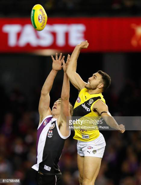 Jack Steele of the Saints and Shane Edwards of the Tigers compete for the ball during the 2017 AFL round 16 match between the St Kilda Saints and the...