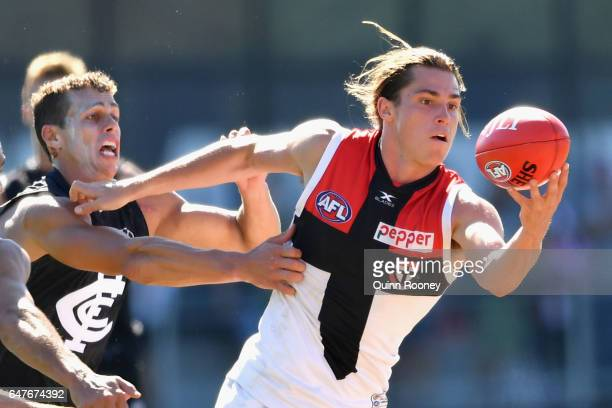 Jack Steele of the Saints is tackled by Ed Curnow of the Blues during the 2017 JLT Community Series AFL match between the Carlton Blues and the St...