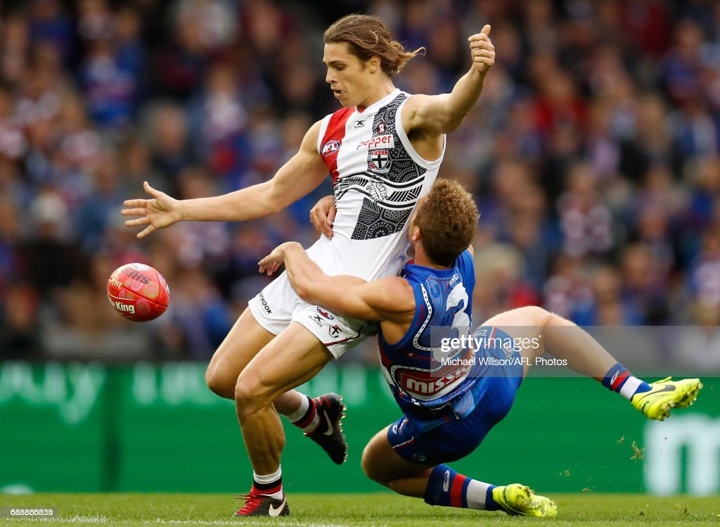 Jack Steele of the Saints is tackled by Mitch Wallis of the Bulldogs during the 2017 AFL round 10 match between the Western Bulldogs and the St Kilda Saints at Etihad Stadium on May 27, 2017 in Melbourne, Australia.